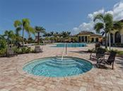 Community Pool & Spa - Condo for sale at 20120 Ragazza Cir #201, Venice, FL 34293 - MLS Number is N6112061