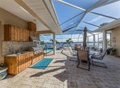 Outdoor kitchen - Single Family Home for sale at 453 Anchorage Dr, Nokomis, FL 34275 - MLS Number is N6112707