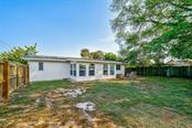 Rear exterior - Single Family Home for sale at 552 Sheridan Dr, Venice, FL 34293 - MLS Number is N6114525