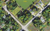 Plat Map over the aerial view - Vacant Land for sale at 108 Rebel Ct, Rotonda West, FL 33947 - MLS Number is D6104818