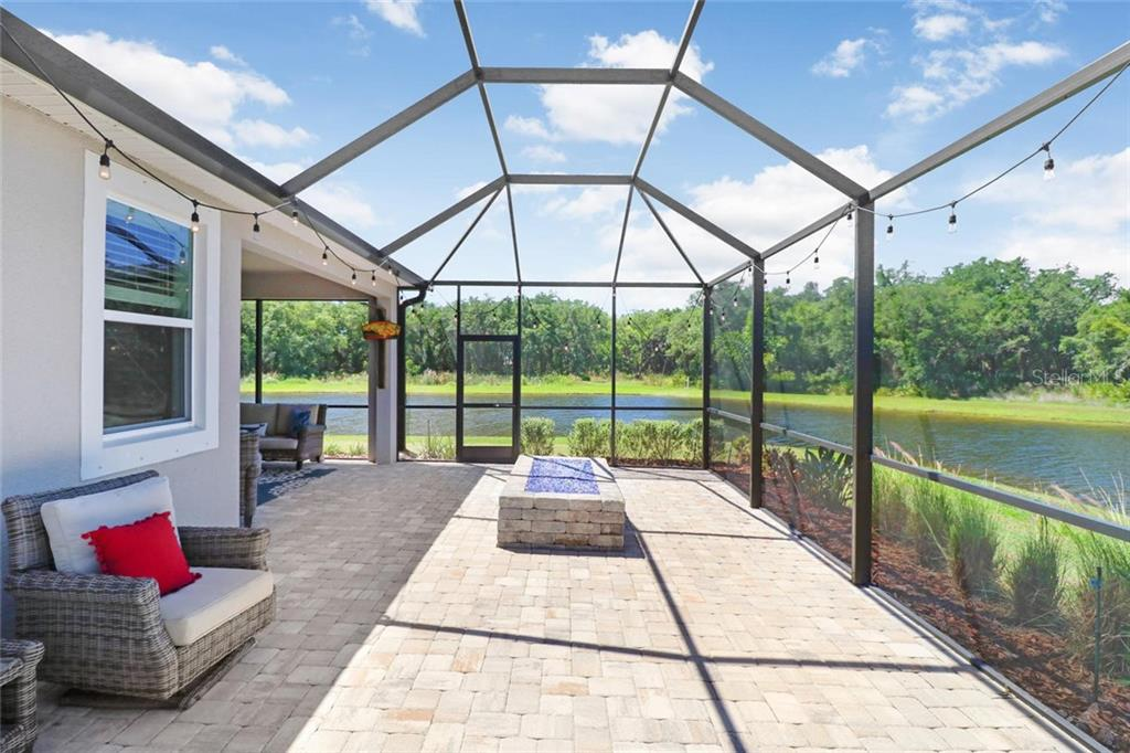 Lots of entertaining space with a gas firepit to enjoy surrounded by water! - Single Family Home for sale at 5332 Applegate Ct, Bradenton, FL 34211 - MLS Number is T3169261