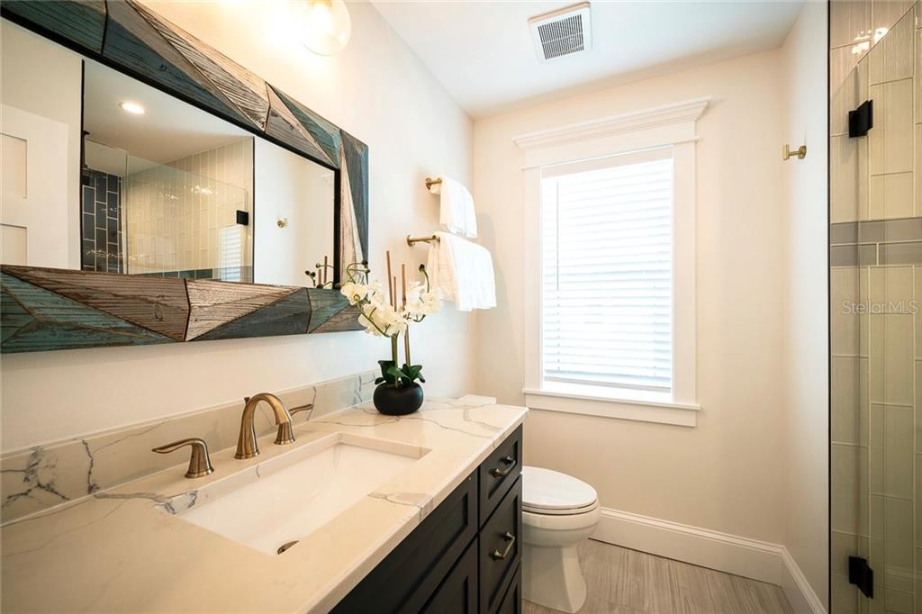 Bedroom four en suite bathroom. - Single Family Home for sale at 206 77th St, Holmes Beach, FL 34217 - MLS Number is T3189824