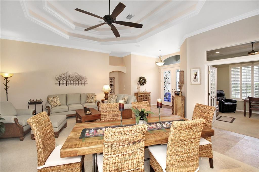 Looking toward the entry from the Dinning area to the living area and den/office. Vaulted ceilings, accent lighting brings a warmth and cozy feeling! - Single Family Home for sale at 1201 San Mateo Dr, Punta Gorda, FL 33950 - MLS Number is U8037798