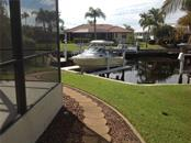 Pathway to your dock with electric, water and lift! - Single Family Home for sale at 1201 San Mateo Dr, Punta Gorda, FL 33950 - MLS Number is U8037798