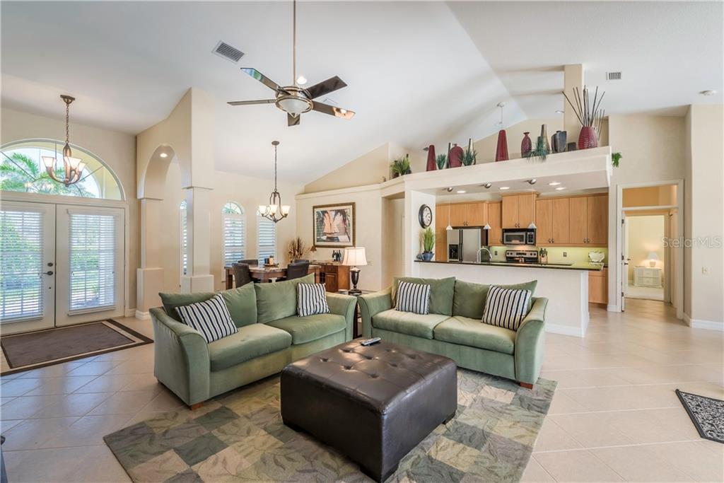 The central gathering space of the home. - Single Family Home for sale at 931 Linkside Way, Punta Gorda, FL 33955 - MLS Number is C7400849