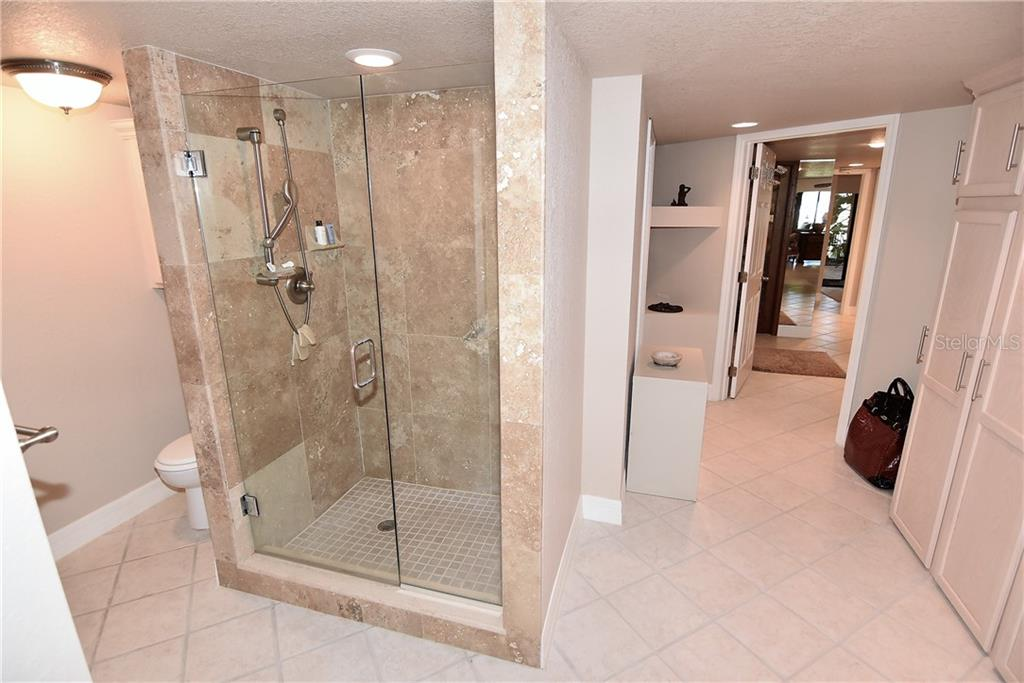 Master Bath has access to storage as well as front foyer - Condo for sale at 3210 Southshore Dr #11a, Punta Gorda, FL 33955 - MLS Number is C7402449