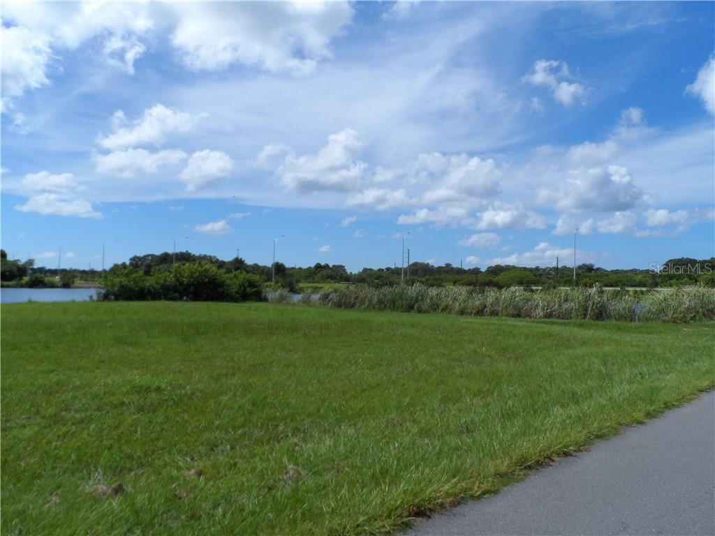 View of the lot to the right - Vacant Land for sale at 119 Rifle Rd, Rotonda West, FL 33947 - MLS Number is C7406393