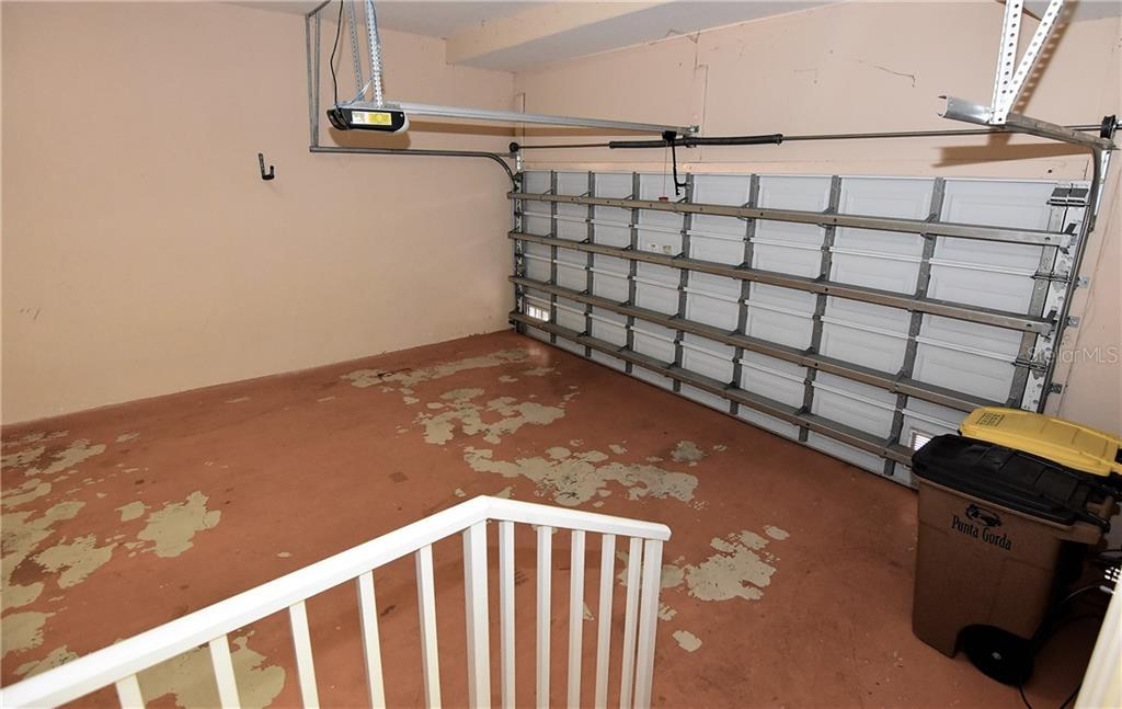 Garage with storage room - Condo for sale at 3959 San Rocco Dr #212, Punta Gorda, FL 33950 - MLS Number is C7409637