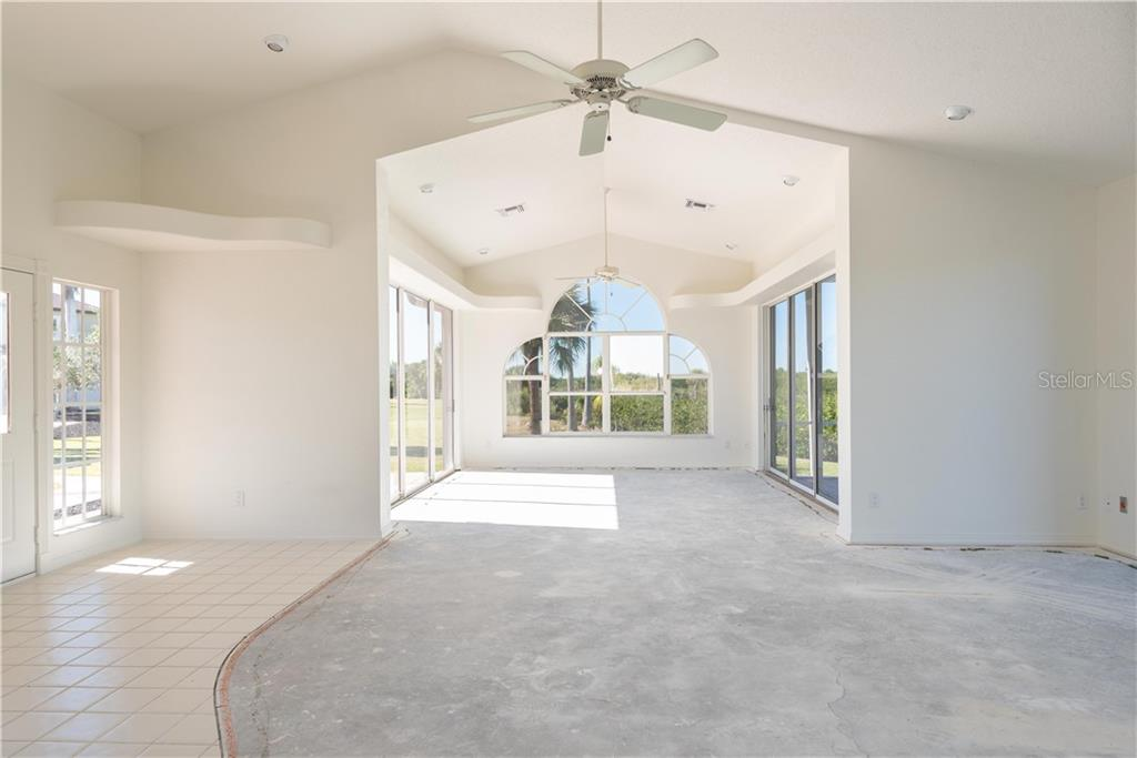 GUEST HOUSE ENTERTAINMENT AREA ON MAIN LEVEL - Single Family Home for sale at 13000 Windcrest Dr, Port Charlotte, FL 33953 - MLS Number is C7410459