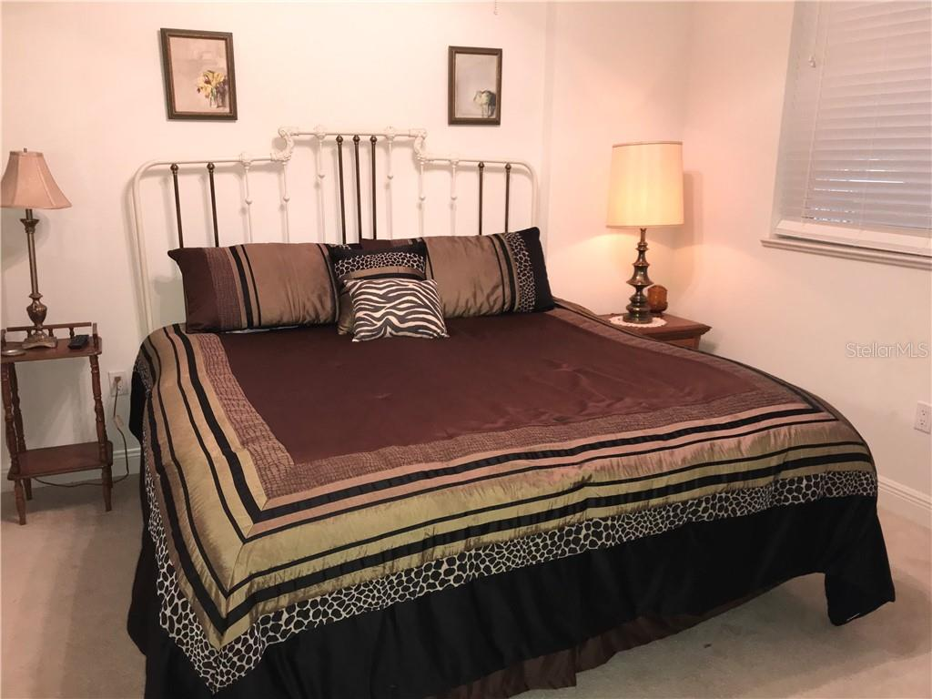 Guest bedroom with private bath and walk in closet - Condo for sale at 3333 Sunset Key Cir #202, Punta Gorda, FL 33955 - MLS Number is C7410701