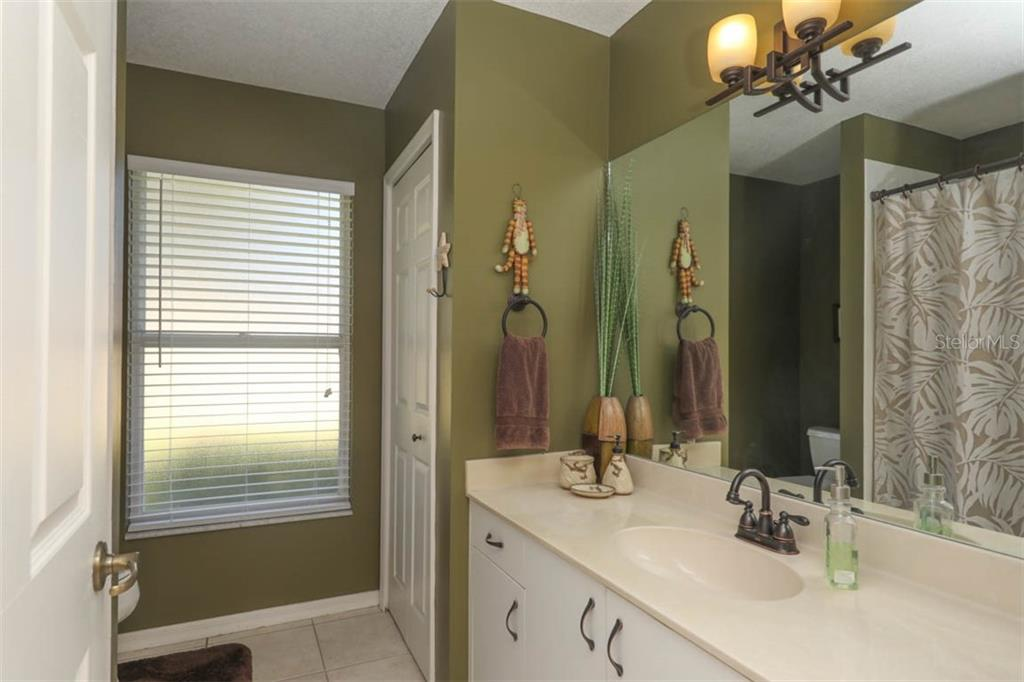 2nd bath features linen closet, combination tub/shower and spacious single sink vanity with generous storage. - Single Family Home for sale at 24620 Dolphin Cove Dr, Punta Gorda, FL 33955 - MLS Number is C7413467