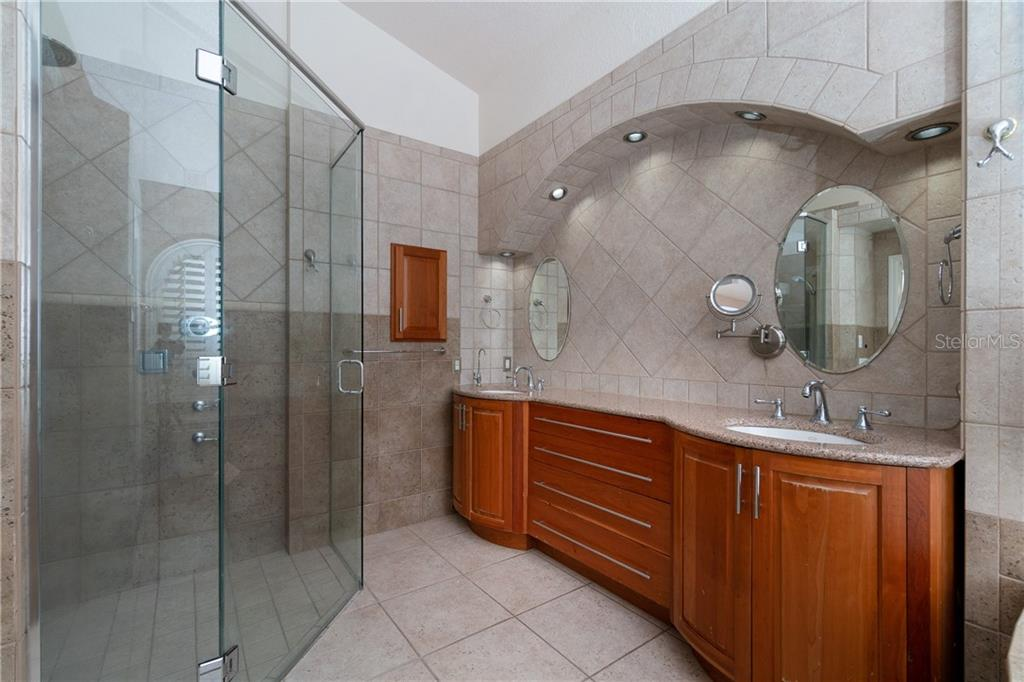This beautiful walk in shower is equipped with a rain head and body sprayers. - Single Family Home for sale at 1309 Casey Key Dr, Punta Gorda, FL 33950 - MLS Number is C7413790