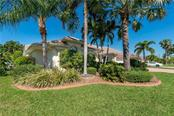 Magnificent Landscaping on all four sides of this elegant home. - Single Family Home for sale at 1309 Casey Key Dr, Punta Gorda, FL 33950 - MLS Number is C7413790