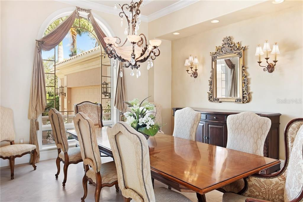 Stunning dining area with a great window for lots of natural light, an inset for a buffet table and a beautiful hand painted barrel-vaulted ceiling. - Single Family Home for sale at 7320 Barclay Ct, University Park, FL 34201 - MLS Number is A4200908