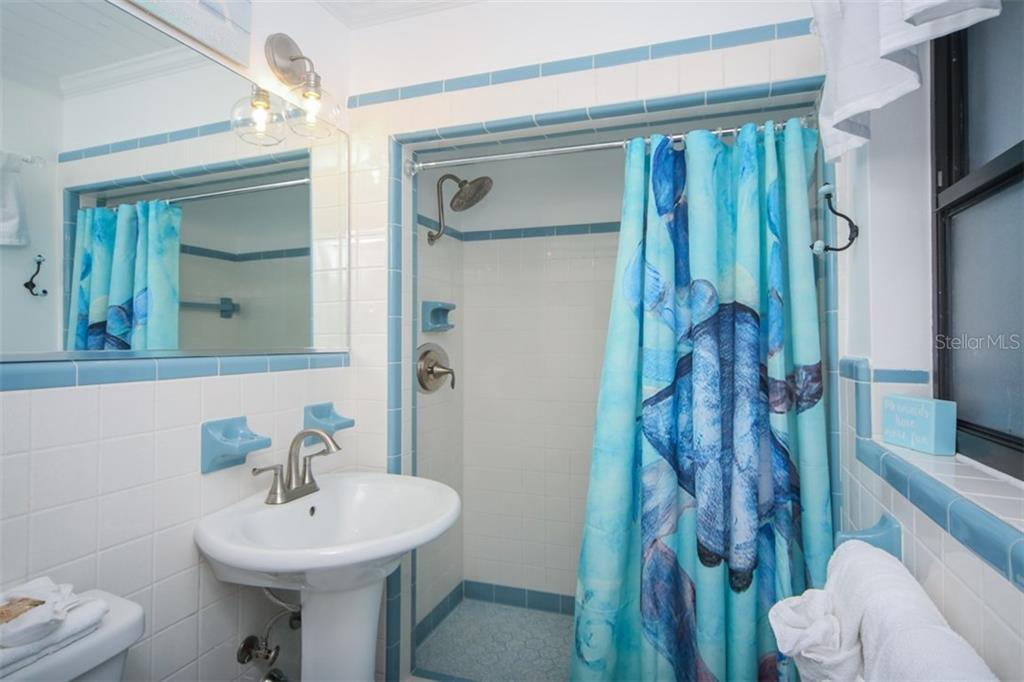Designer fixtures and bathroom vanity - Single Family Home for sale at 213 70th St, Holmes Beach, FL 34217 - MLS Number is A4202171