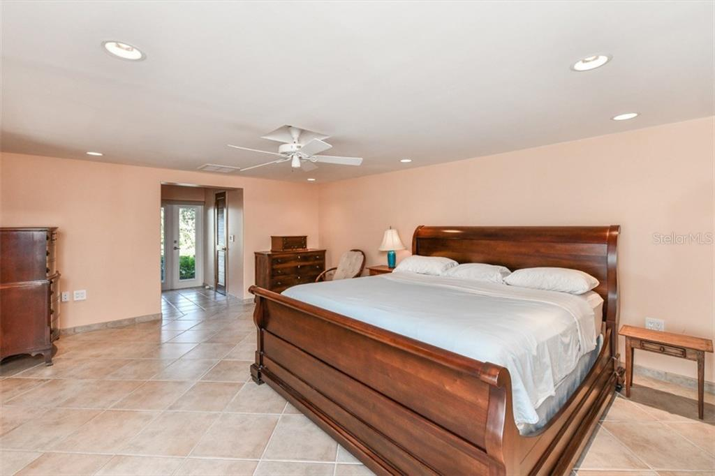 down stairs large master bedroom - Single Family Home for sale at 1809 Sandalwood Dr, Sarasota, FL 34231 - MLS Number is A4206226