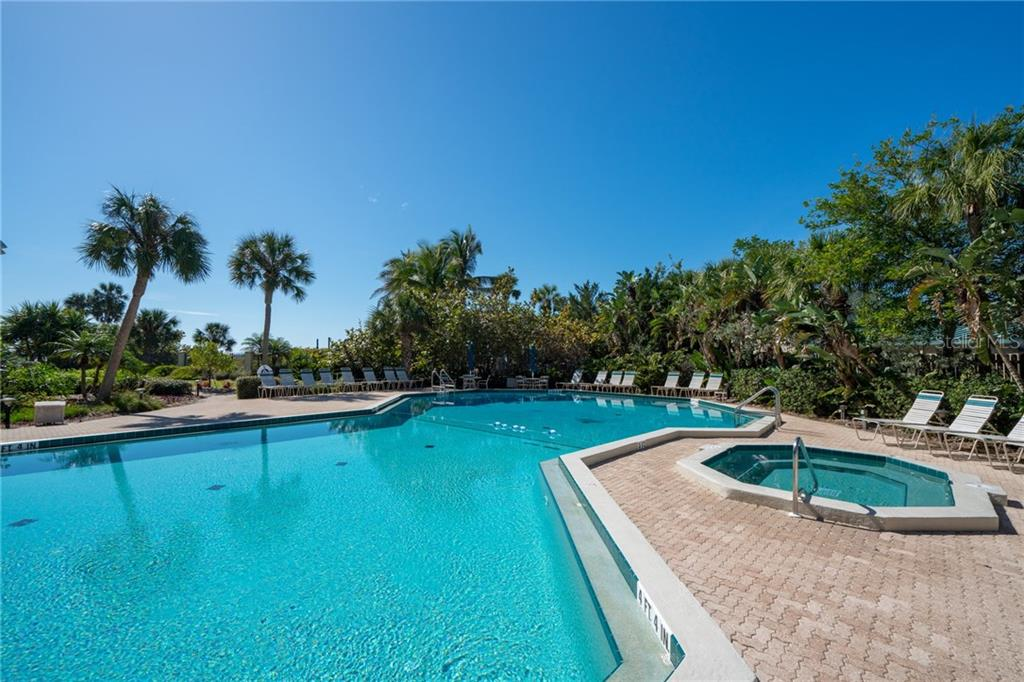 Swimming pool, spa and paver brick sun deck - Condo for sale at 5880 Midnight Pass Rd #511, Sarasota, FL 34242 - MLS Number is A4207131