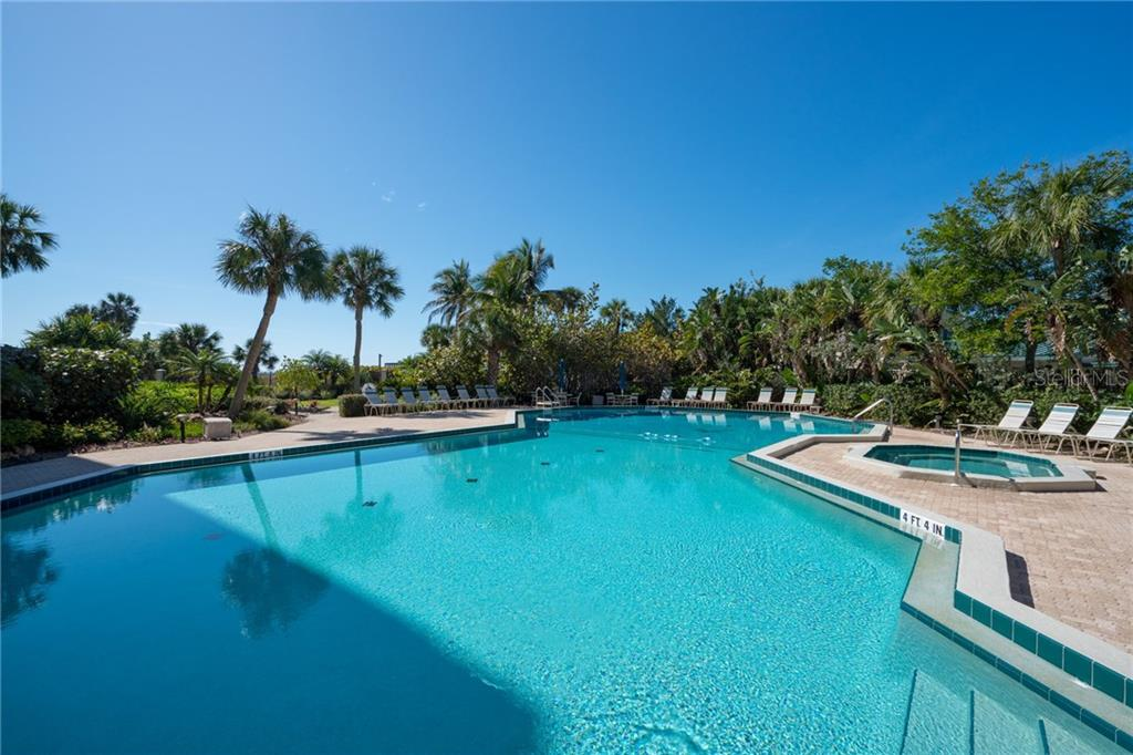 Swimming pool, spa and paver brick sun deck - Condo for sale at 5880 Midnight Pass Rd #810, Sarasota, FL 34242 - MLS Number is A4208619