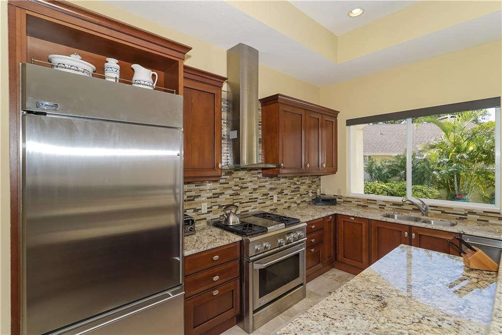 Beautifully appointment kitchen with walk-in pantry - Single Family Home for sale at 1179 Morningside Pl, Sarasota, FL 34236 - MLS Number is A4209174