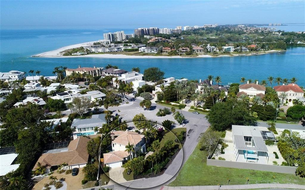 Aerial view looking North/Northwest over New Pass to Gulf of Mexico - Single Family Home for sale at 1179 Morningside Pl, Sarasota, FL 34236 - MLS Number is A4209174