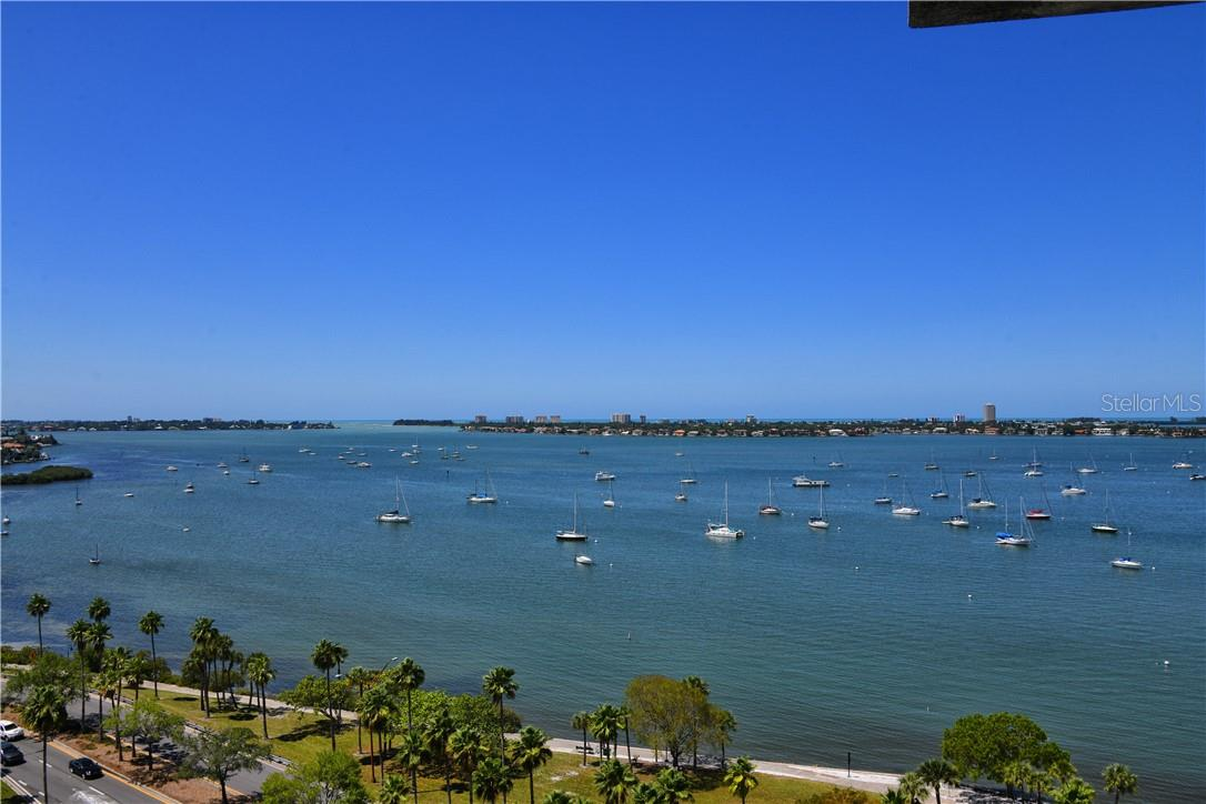 Retreat to the light filled owners' suite bedroom, with direct views to the bay. - Condo for sale at 605 S Gulfstream Ave #4n, Sarasota, FL 34236 - MLS Number is A4400519