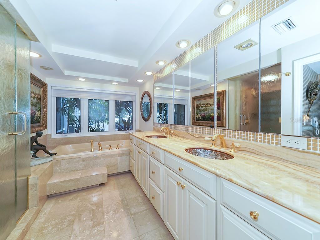 Master Bathroom - Large Glass shower and Soaking Tub - Single Family Home for sale at 916 N Casey Key Rd, Osprey, FL 34229 - MLS Number is A4408082
