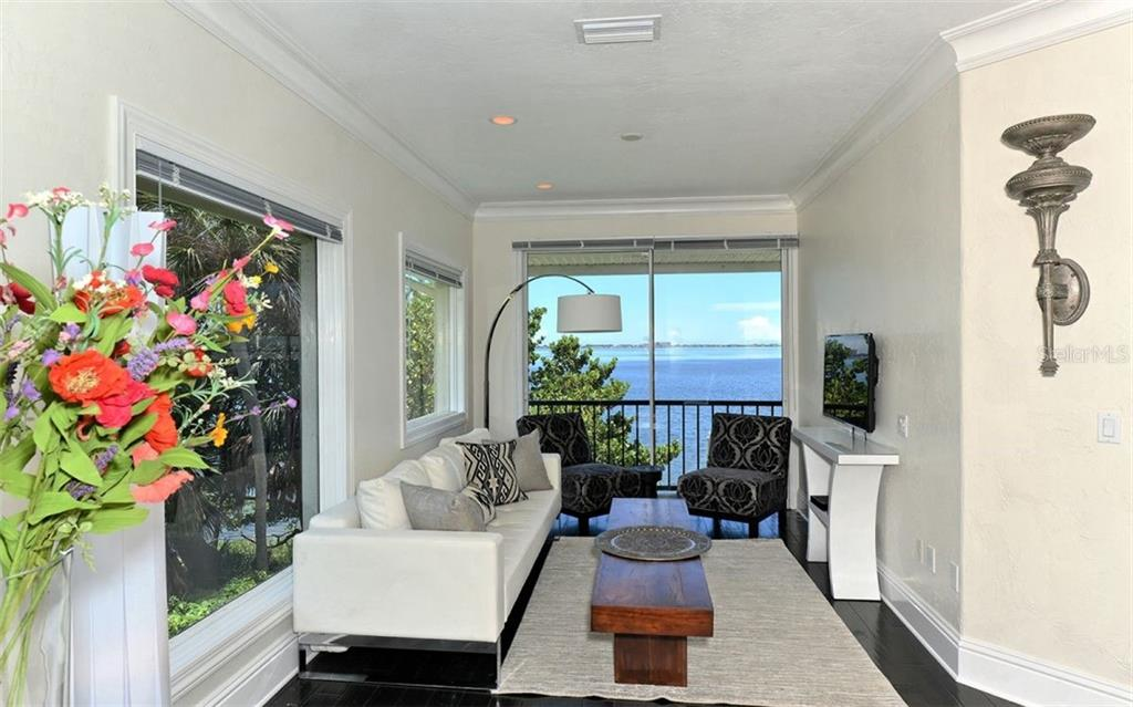 The master suite includes an idyllic sitting area with private balcony. - Single Family Home for sale at 2145 Alameda Ave, Sarasota, FL 34234 - MLS Number is A4414337
