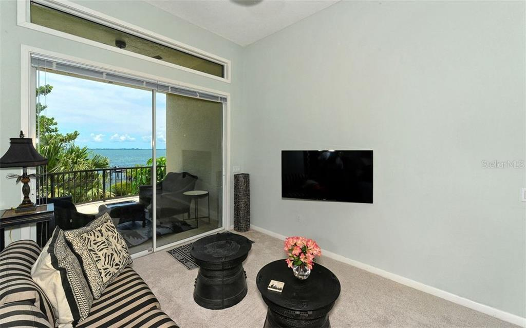 Sitting area & balcony off of first floor master or guest room. - Single Family Home for sale at 2145 Alameda Ave, Sarasota, FL 34234 - MLS Number is A4414337