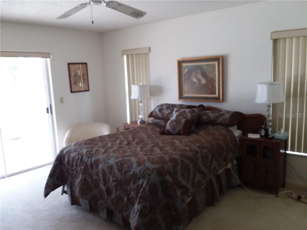 Master bedroom - sliders to lanai - Single Family Home for sale at 3176 E Village Dr, Venice, FL 34293 - MLS Number is A4417064
