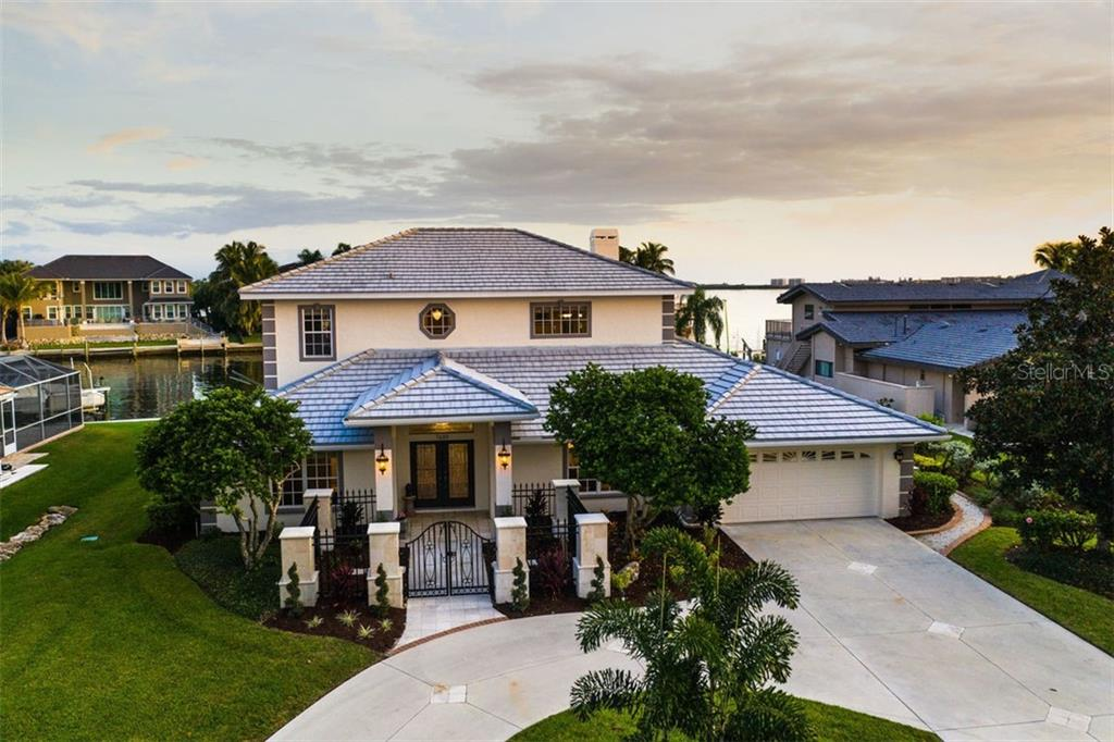 Idyllic Sarasota waterfront residence. - Single Family Home for sale at 7689 Cove Ter, Sarasota, FL 34231 - MLS Number is A4417242