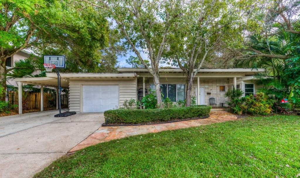 A tandem two car carport has been added next to the single car garage complete with a huge storage room. - Single Family Home for sale at 1509 Flower Dr, Sarasota, FL 34239 - MLS Number is A4421898