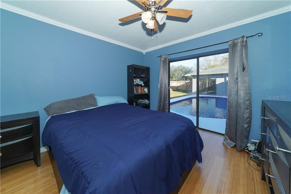 Bedroom with pool view. - Single Family Home for sale at 8106 Timber Lake Ln, Sarasota, FL 34243 - MLS Number is A4423770