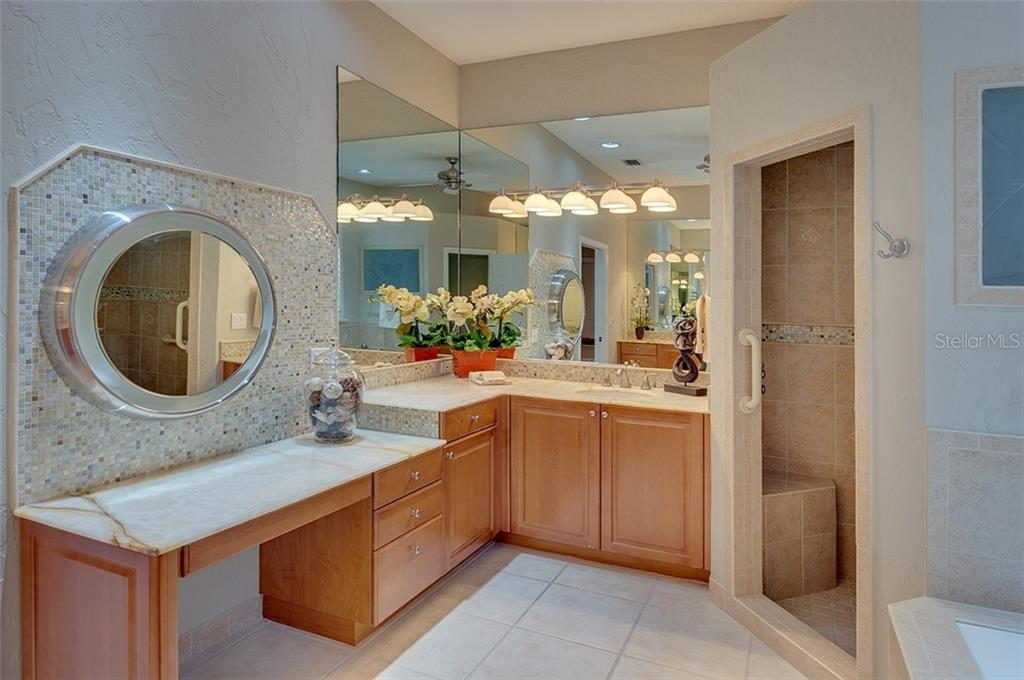 Master bath with dual sinks and large vanity area. - Single Family Home for sale at 2972 Jeff Myers Cir, Sarasota, FL 34240 - MLS Number is A4424133
