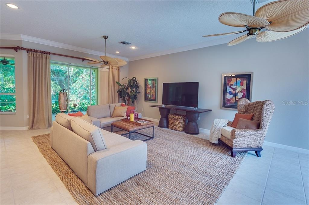 Great room with sliders leading to the back lanai. - Single Family Home for sale at 2972 Jeff Myers Cir, Sarasota, FL 34240 - MLS Number is A4424133