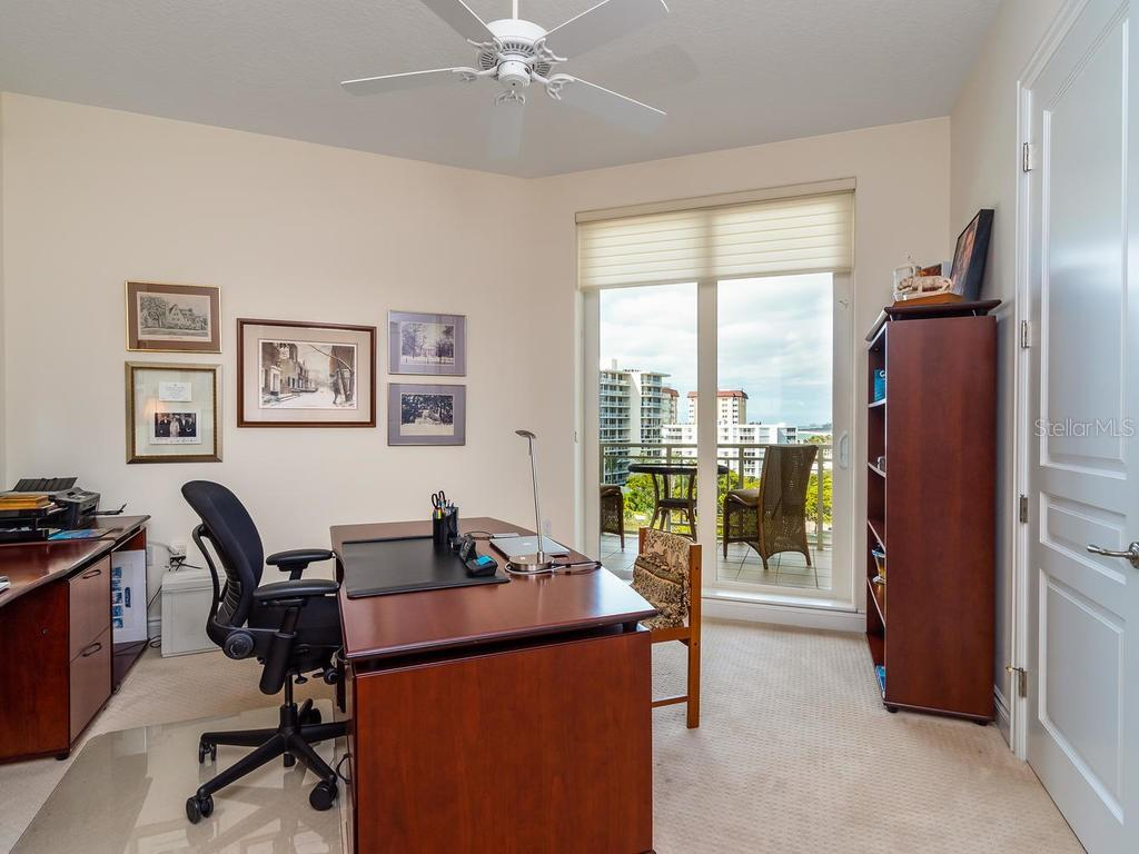 Guest suite 3 (currently used as an office) with a private bathroom, large closet, and access to second balcony. - Condo for sale at 2050 Benjamin Franklin Dr #a702, Sarasota, FL 34236 - MLS Number is A4424335