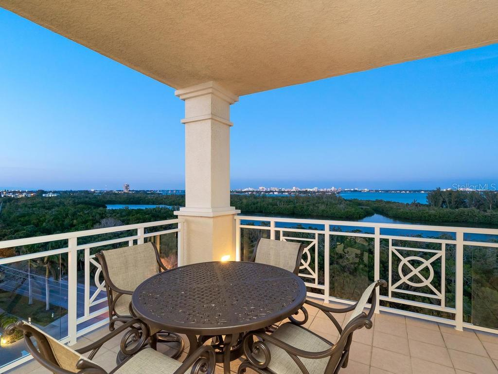 View from main balcony at twilight. - Condo for sale at 2050 Benjamin Franklin Dr #a702, Sarasota, FL 34236 - MLS Number is A4424335
