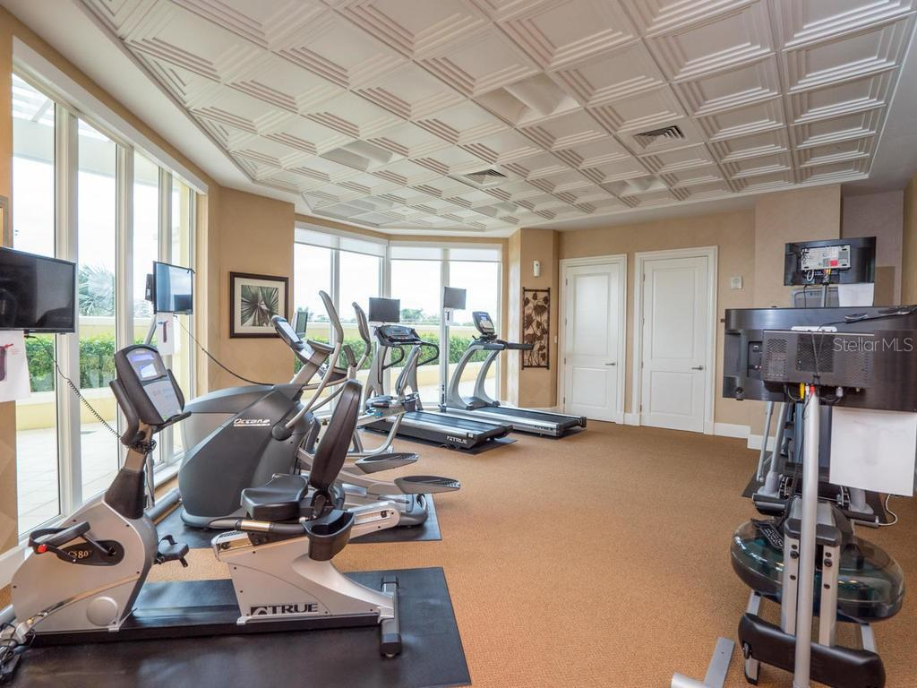 Fitness center cardio equipment - Orchid Beach Club. - Condo for sale at 2050 Benjamin Franklin Dr #a702, Sarasota, FL 34236 - MLS Number is A4424335