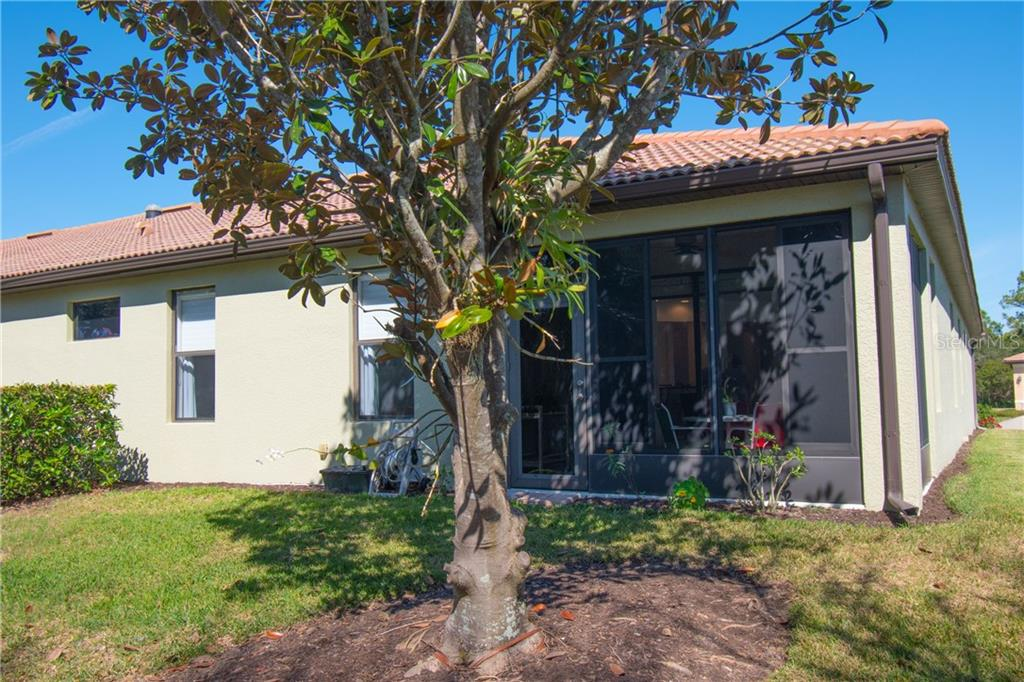 Back view of the Villa - Villa for sale at 1808 Batello Dr, Venice, FL 34292 - MLS Number is A4426491