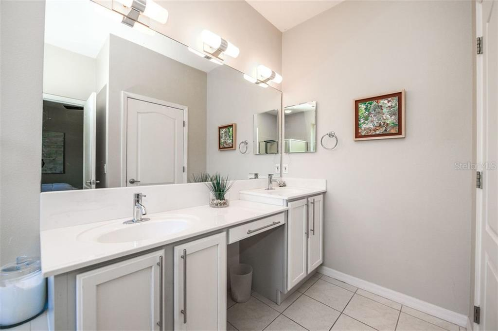 Master Bath, dual sinks. Designer hardware and faucets. - Single Family Home for sale at 702 Anna Hope Ln, Osprey, FL 34229 - MLS Number is A4427993