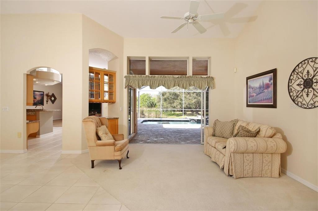Large open kitchen with solid wood cabinets and granite counters - Single Family Home for sale at 1329 Oak Point Ct, Venice, FL 34292 - MLS Number is A4428059