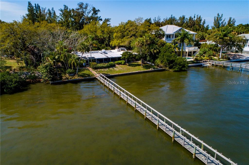 Single Family Home for sale at 7501 Midnight Pass Rd, Sarasota, FL 34242 - MLS Number is A4429790