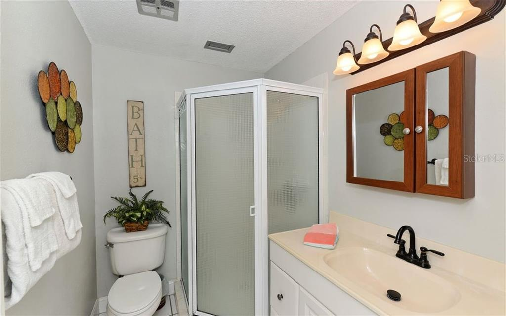 Guest Bathroom. - Condo for sale at 797 Beach Rd #215, Sarasota, FL 34242 - MLS Number is A4430524