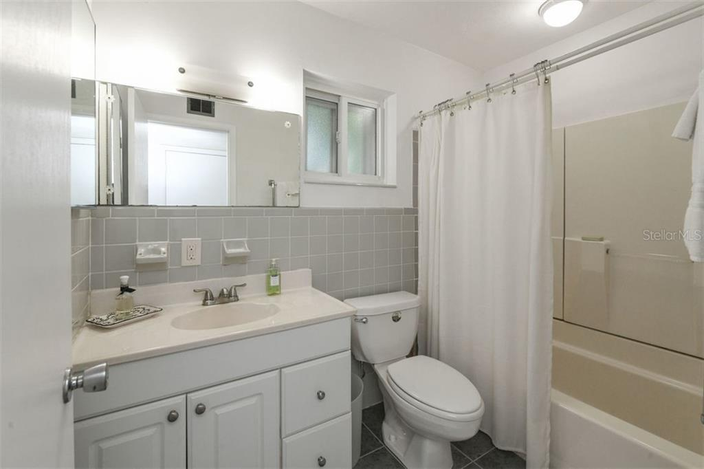 The second bathroom incorporates the new with the vintage. - Single Family Home for sale at 7727 Westmoreland Dr, Sarasota, FL 34243 - MLS Number is A4430900