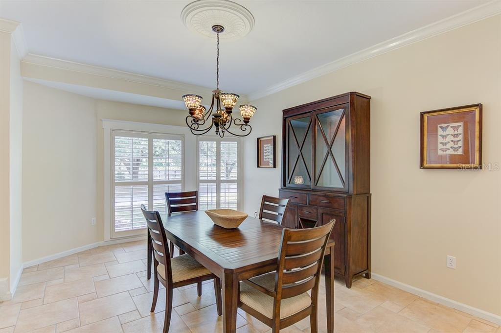 Dining room with Plantation shutters and architectural accents - Single Family Home for sale at 7945 Palmer Blvd, Sarasota, FL 34240 - MLS Number is A4431318