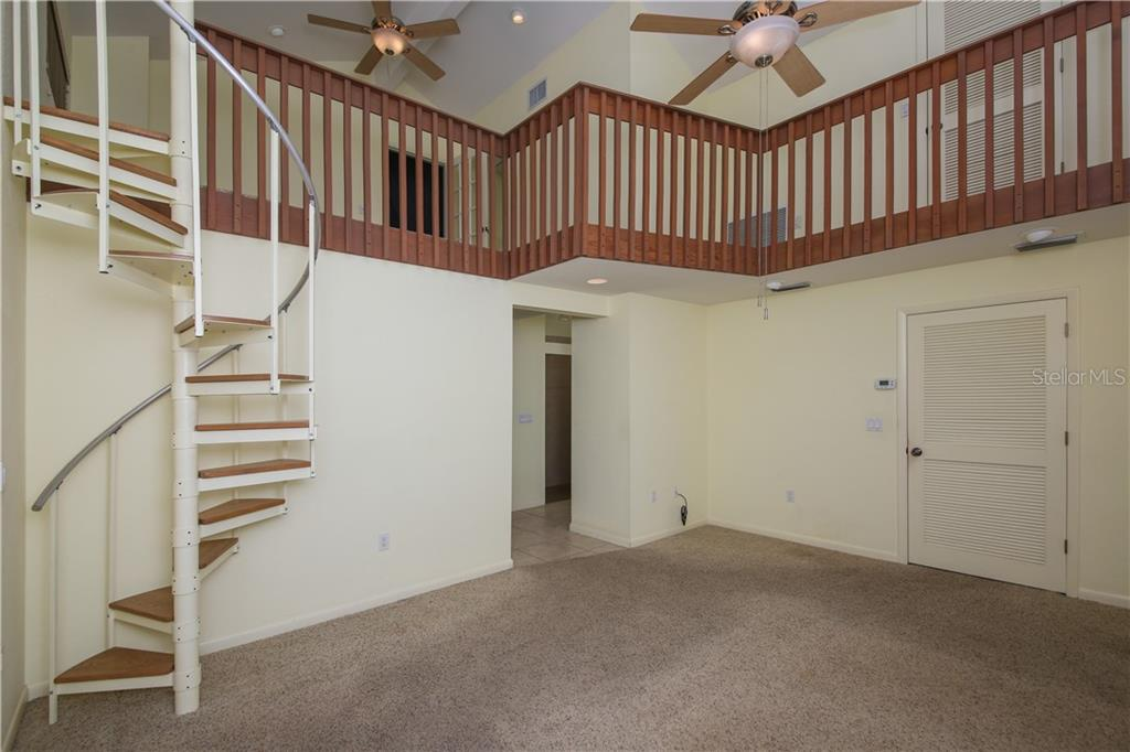 Master bedroom looking up to loft area - Single Family Home for sale at 7611 Alhambra Dr, Bradenton, FL 34209 - MLS Number is A4434753