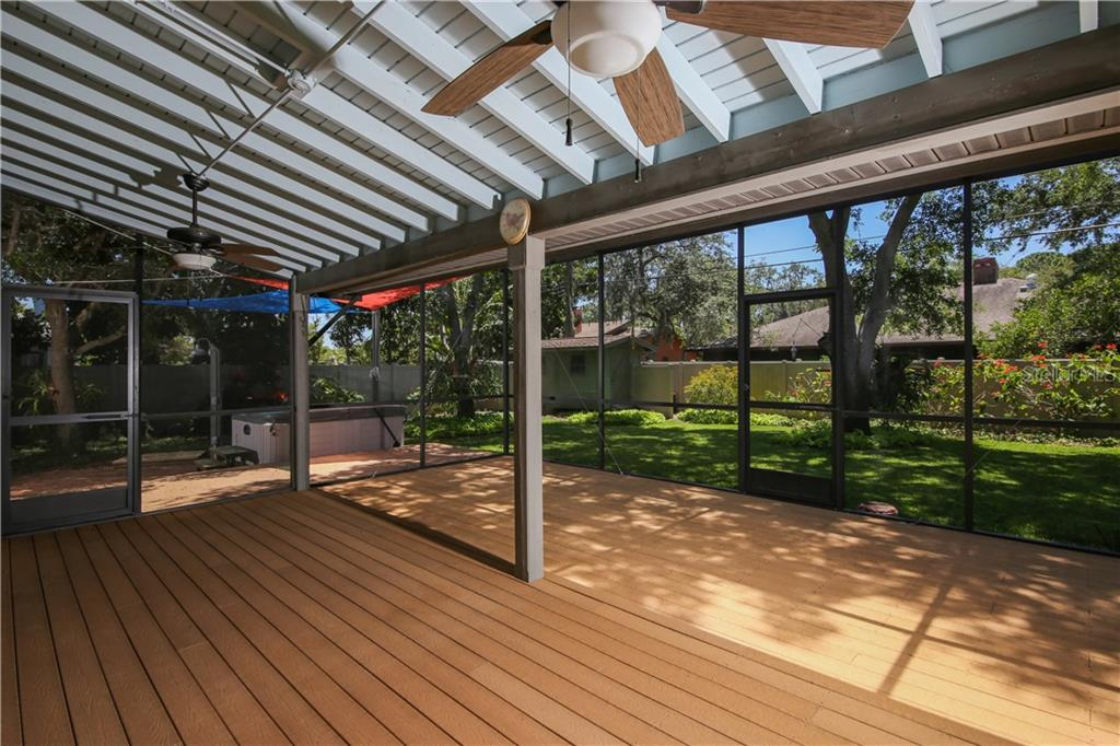 Large covered lanai w/screen extension and ceiling fans. Pull down shade screen on west side of porch. Decking is Evergrain - Single Family Home for sale at 7611 Alhambra Dr, Bradenton, FL 34209 - MLS Number is A4434753