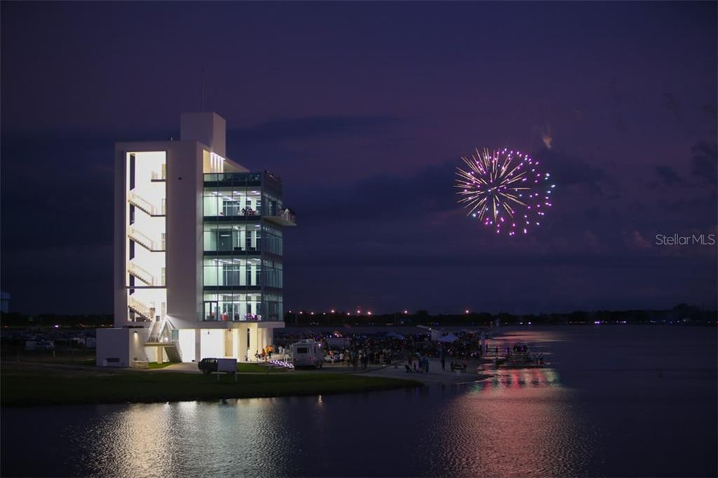 A beautiful fireworks display over neighboring Nathan Benderson Park following one of the many festivals. - Condo for sale at 5602 Sheffield Greene Cir #2, Sarasota, FL 34235 - MLS Number is A4436218