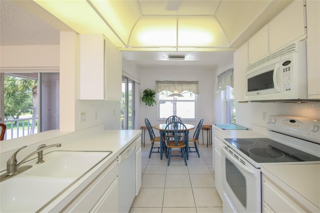 The kitchen is light and bright with plenty of room for an eat in kitchen. - Condo for sale at 5602 Sheffield Greene Cir #2, Sarasota, FL 34235 - MLS Number is A4436218