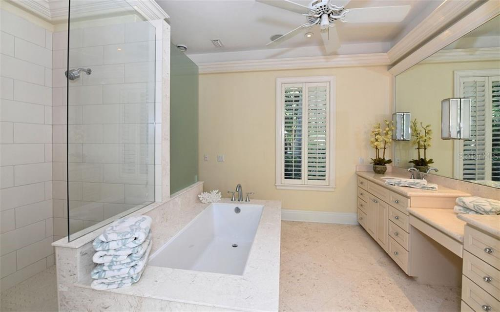 First floor master bathroom - Single Family Home for sale at 65 Lighthouse Point Dr, Longboat Key, FL 34228 - MLS Number is A4438181