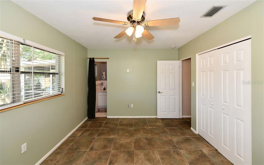 Master bedroom & en suite bath. - Single Family Home for sale at 120 23rd Street Ct Ne, Bradenton, FL 34208 - MLS Number is A4438232